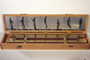 The Highest I Can Jump-oak, photo etching. The brass bar represents the greatest