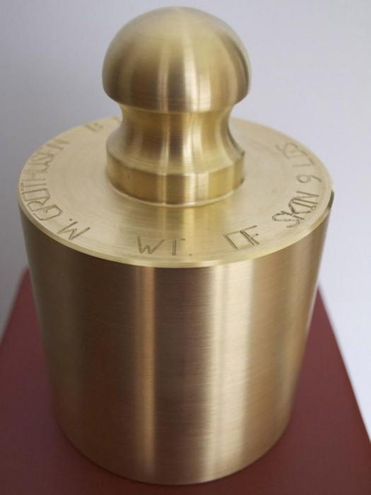 "Weight of Skin, brass, oak. 40""x8""x8"". The brass weight corresponds to the weigh"